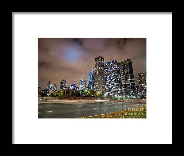 Downtown Framed Print featuring the photograph View Of Chicago Skyscrappers With Busy Street In The Foreground by PorqueNo Studios