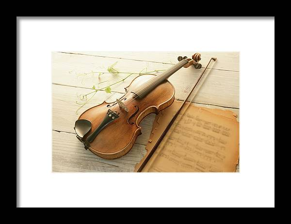 Sheet Music Framed Print featuring the photograph Violin And Music Sheet by Image Work/amanaimagesrf