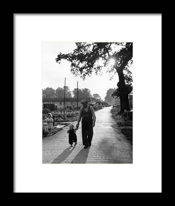 Toddler Framed Print featuring the photograph Walking In Sunshine by Bert Hardy