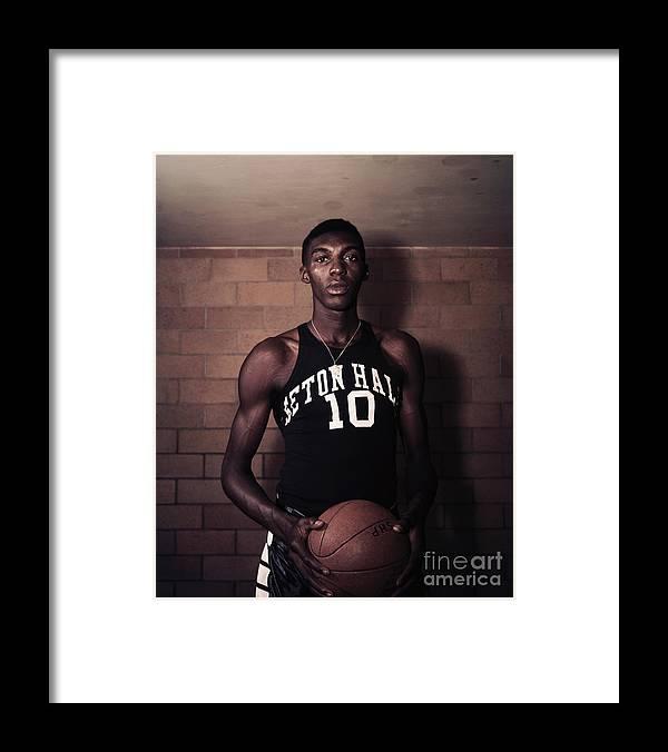 People Framed Print featuring the photograph Walt Dukes Holding Basketball by Bettmann