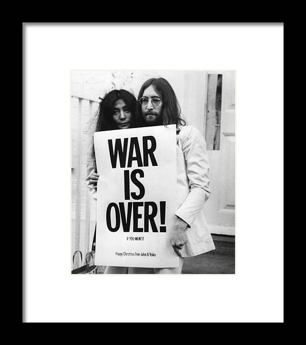 Rock Music Framed Print featuring the photograph War Is Over by Frank Barratt
