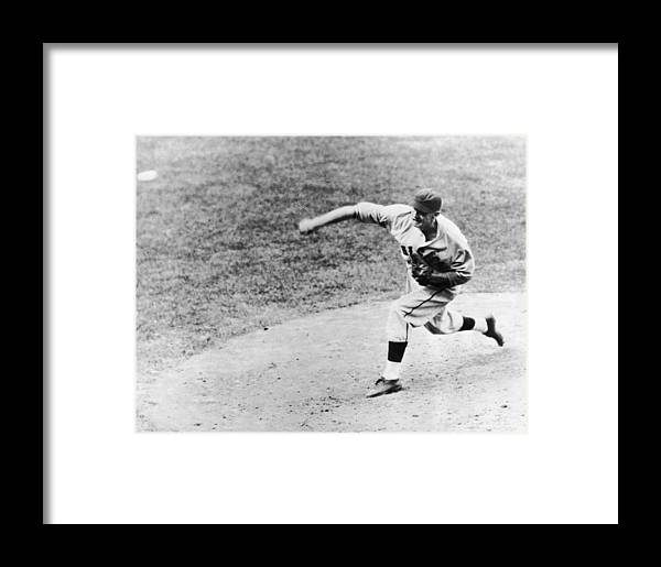 American League Baseball Framed Print featuring the photograph Warneke Pitches In The World Series by Fpg