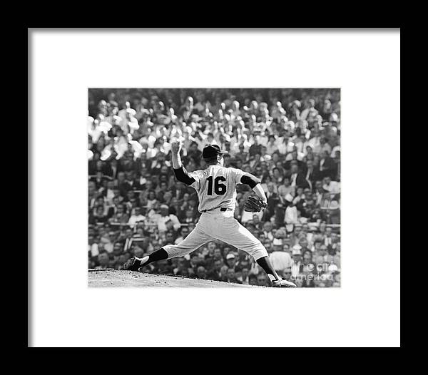 American League Baseball Framed Print featuring the photograph Whitey Ford Winds Up by Robert Riger