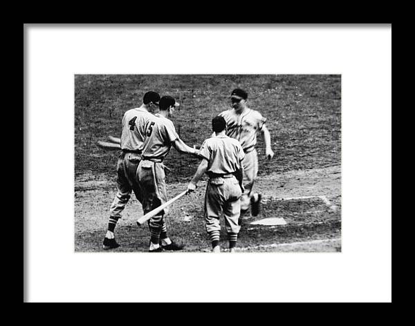 St. Louis Cardinals Framed Print featuring the photograph Whitey Kurowski Comes Home by Hulton Archive