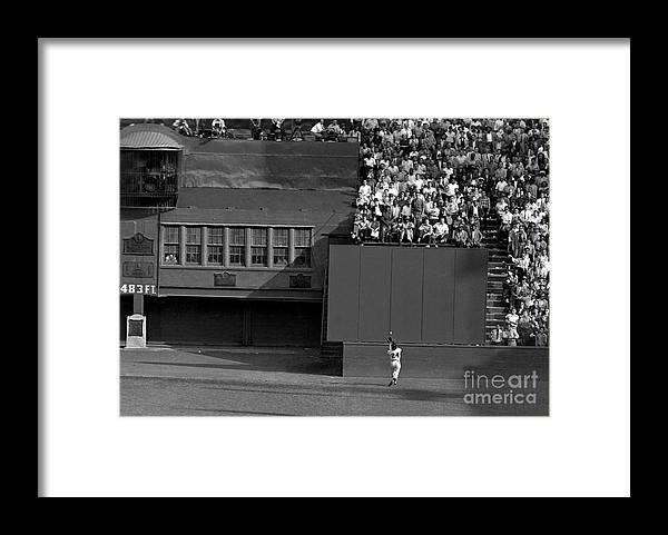 1950-1959 Framed Print featuring the photograph Willie Mays Makes His Famous Catch Off by New York Daily News Archive