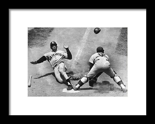 Headwear Framed Print featuring the photograph Willie Mays Sliding Into Home Plate by Bettmann