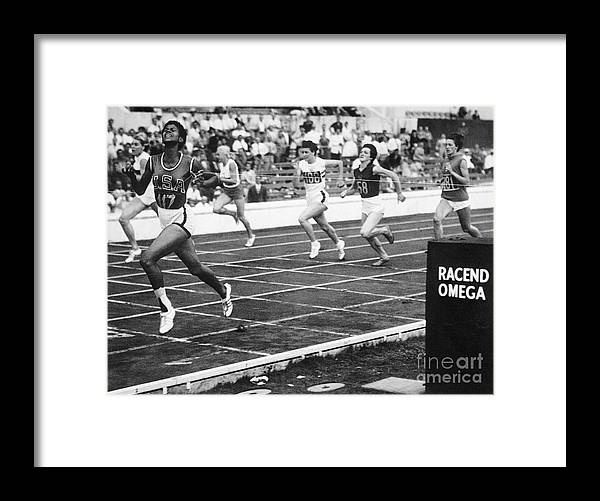 Event Framed Print featuring the photograph Wilma Rudolph Sprinting Across Finish by Bettmann