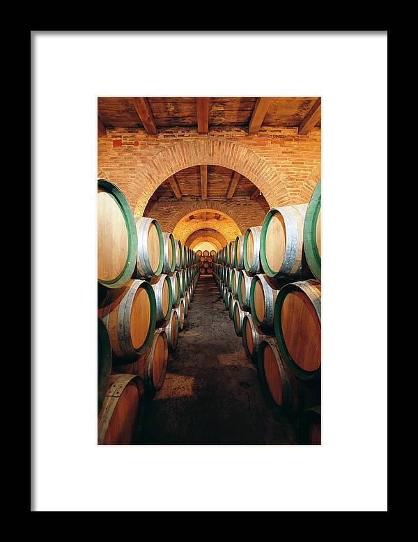 Working Framed Print featuring the photograph Wine Barrels In Cellar, Spain by Johner Images