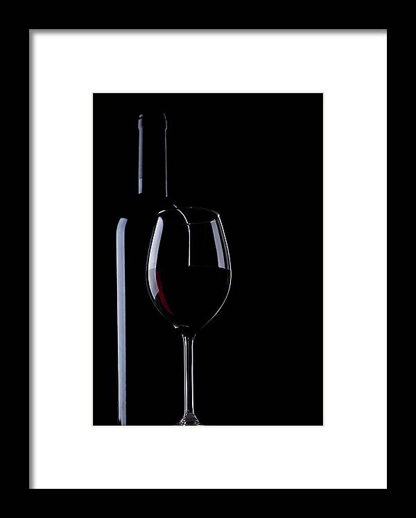 Curve Framed Print featuring the photograph Wine Bottle And Glass by Portishead1