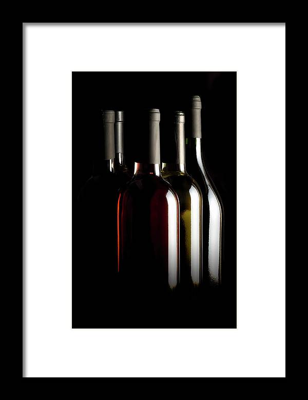 Rose Wine Framed Print featuring the photograph Wine Bottles by Carlosalvarez