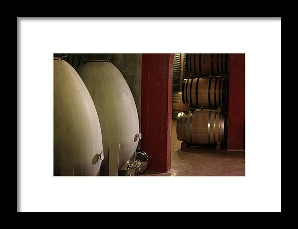 Aging Process Framed Print featuring the photograph Wine Cellar by Tom And Steve