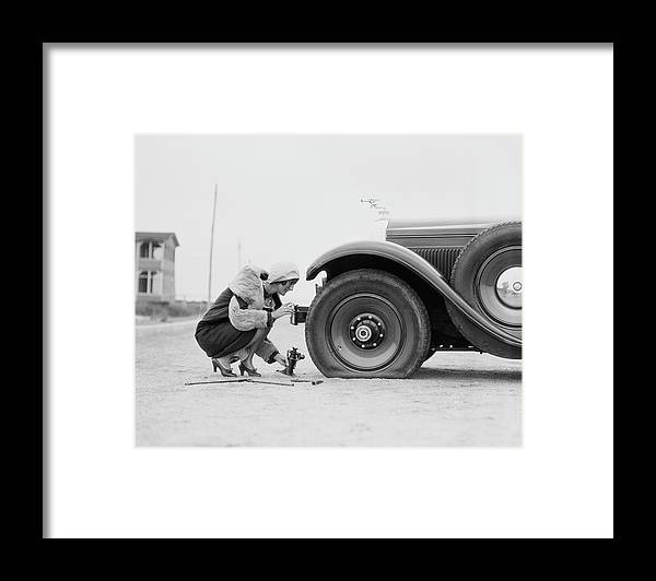 People Framed Print featuring the photograph Woman Changing Flat Tire On Car by H. Armstrong Roberts