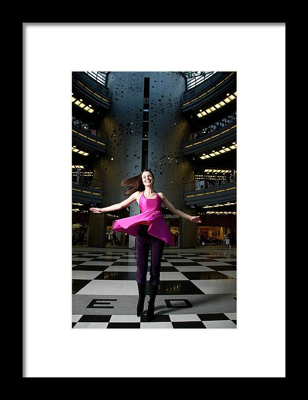 People Framed Print featuring the photograph Woman Dancing In Old Brewery Shopping by Tim E White