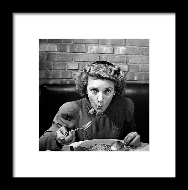 Timeincown Framed Print featuring the photograph Woman Eating Spaghetti In Restaurant 5 by Alfred Eisenstaedt