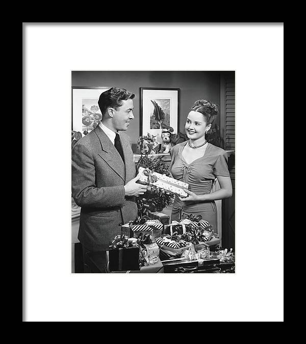Heterosexual Couple Framed Print featuring the photograph Woman Giving Gift To Man, B&w by George Marks