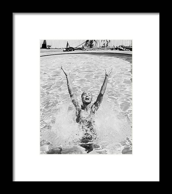 Human Arm Framed Print featuring the photograph Woman Having Fun In Swimming Pool by Tom Kelley Archive