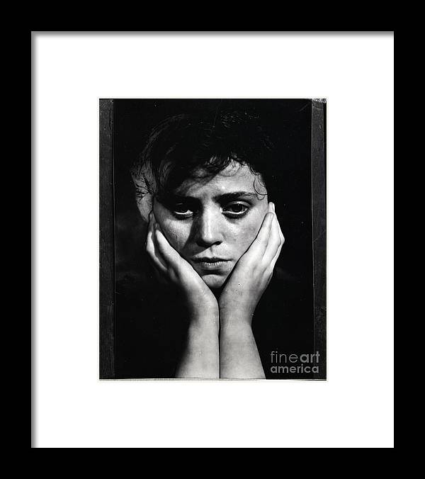 People Framed Print featuring the photograph Woman Holding Her Head by Bettmann