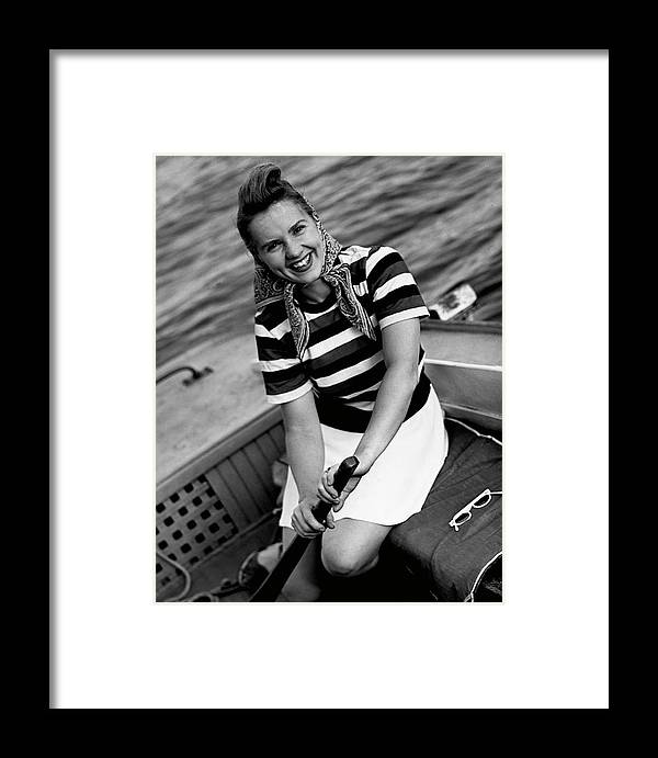 Three Quarter Length Framed Print featuring the photograph Woman In A Speedboat by George Marks