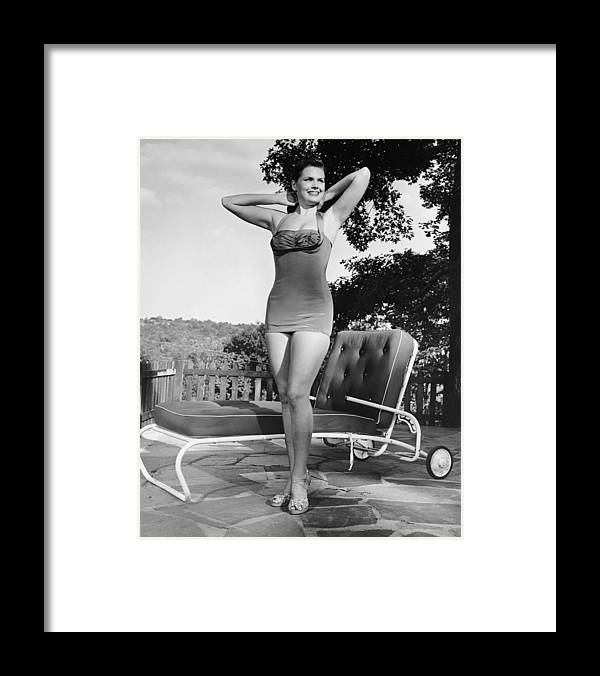 People Framed Print featuring the photograph Woman In Bathing Suit Outdoors by George Marks