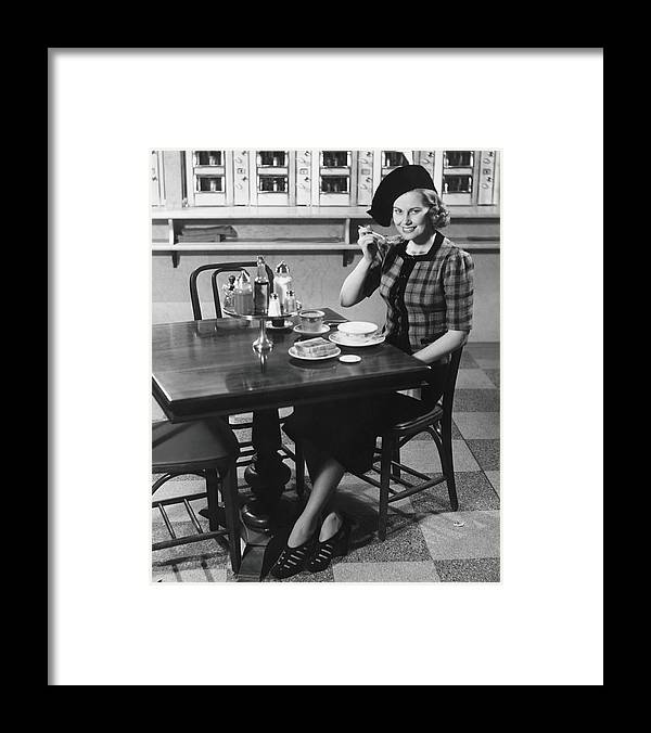 Breakfast Framed Print featuring the photograph Woman In Fancy Hat Eating Breakfast In by George Marks