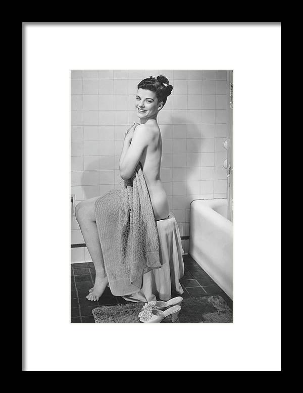 Looking Over Shoulder Framed Print featuring the photograph Woman Sitting In Bathroom, Covering by George Marks