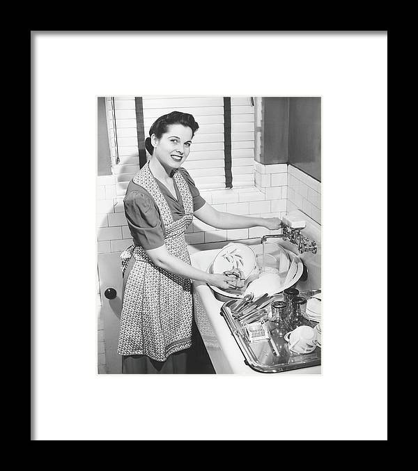 Three Quarter Length Framed Print featuring the photograph Woman Washing Dishes In Kitchen Sink by George Marks