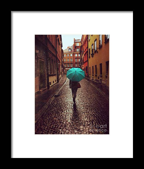 Couple Framed Print featuring the photograph Woman With Umbrella Walking On The Rain by Happy Moments