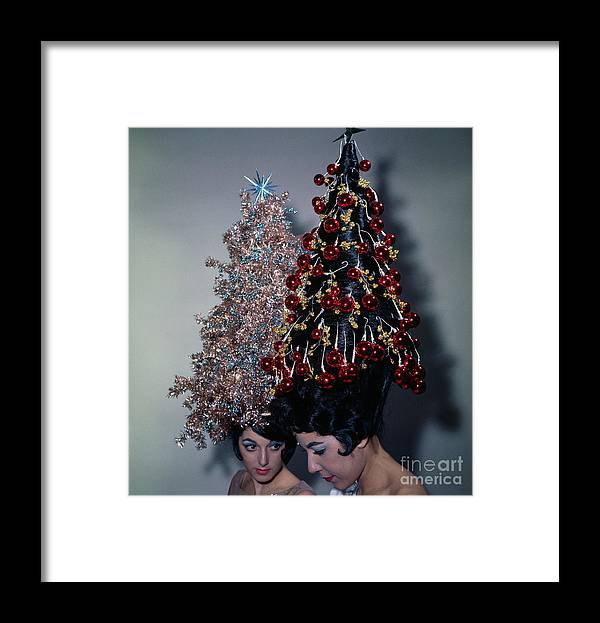 People Framed Print featuring the photograph Women Modeling Festive Christmas Hairdos by Bettmann