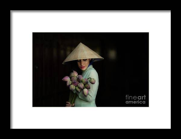 Chinese Culture Framed Print featuring the photograph Women Vietnam In Ao Dai Traditional by Sutiporn Somnam