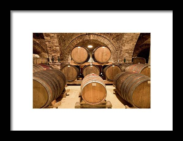Arch Framed Print featuring the photograph Wooden Barrels In Wine Cellar by Benedek