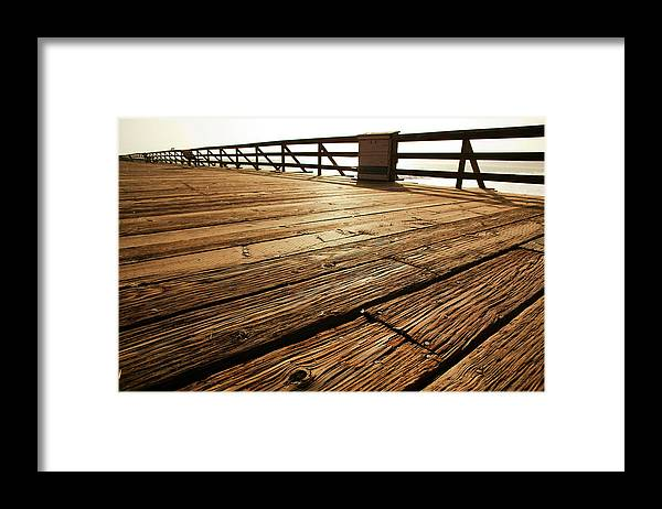 Scenics Framed Print featuring the photograph Wooden Pier by Timnewman