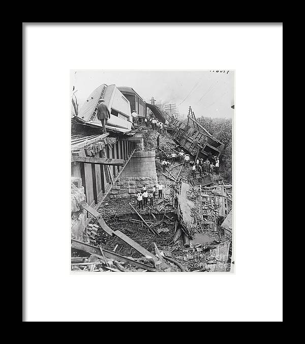People Framed Print featuring the photograph Workers On Train Wreck Debris by Bettmann