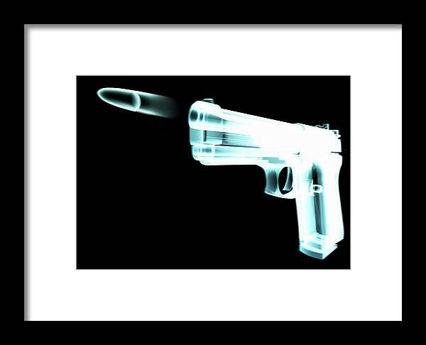 Motion Framed Print featuring the digital art X-ray Of Gun Firing Bullet Digital by Gary Cornhouse
