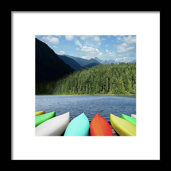 Scenics Framed Print featuring the photograph Xxl Canoes And Mountain Lake by Sharply done