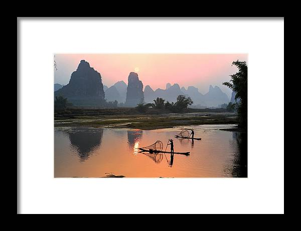 Chinese Culture Framed Print featuring the photograph Yangshuo Li River At Sunset by Kingwu