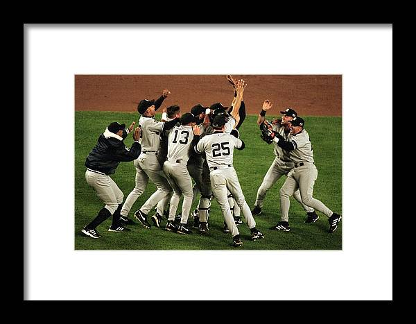 Celebration Framed Print featuring the photograph Yankees Celebrate by Al Bello
