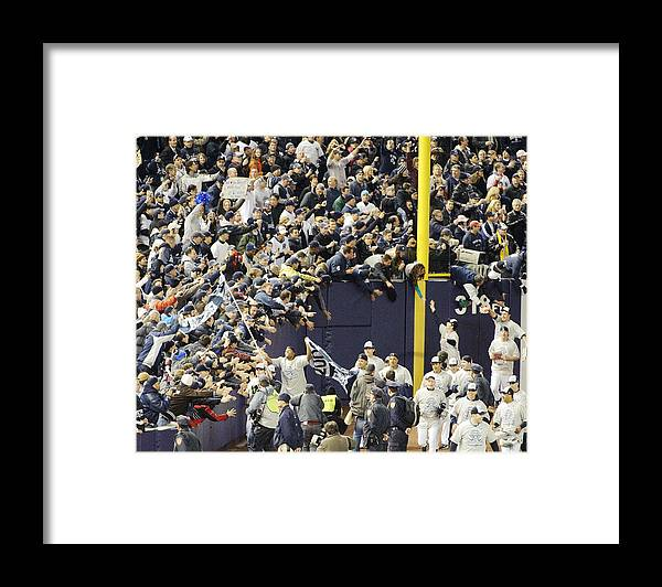 People Framed Print featuring the photograph Yankees Fans Reach Out To Touch by New York Daily News Archive