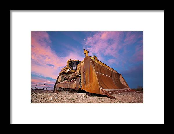 Toughness Framed Print featuring the photograph Yellow Bulldozer Working At Sunset by Wesvandinter