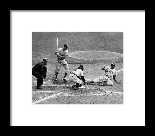 1950-1959 Framed Print featuring the photograph Yogi Has It Out. Jackie Robinson, With by New York Daily News Archive