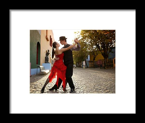 Young Men Framed Print featuring the photograph Young Couple Dancing Tango In Street by Buena Vista Images