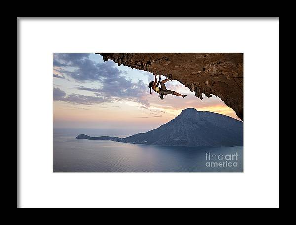 Beauty Framed Print featuring the photograph Young Female Rock Climber At Sunset by Photobac