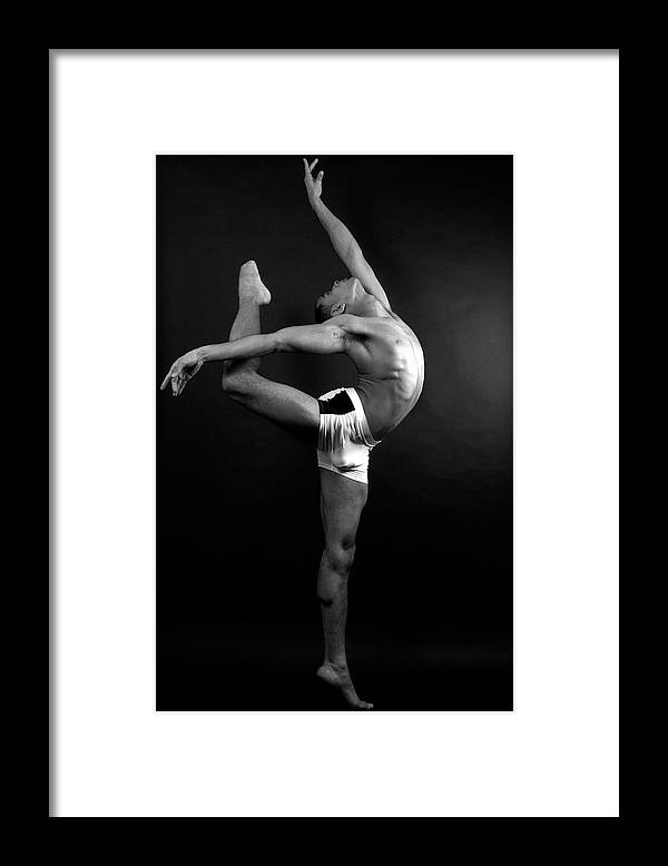 Human Arm Framed Print featuring the photograph Young Male In Dancer Pose by Michael Rowe