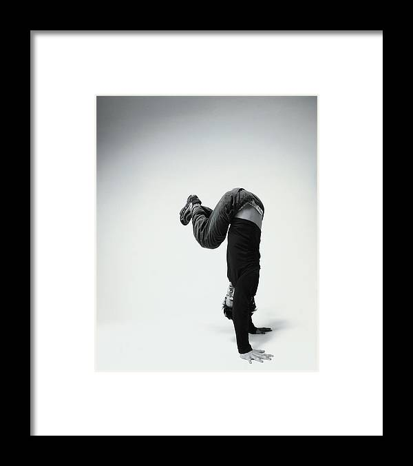 Youth Culture Framed Print featuring the photograph Young Man Breakdancing B&w by Karen Moskowitz