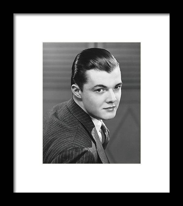 Young Men Framed Print featuring the photograph Young Man Wearing Pinstripe Jacket by George Marks