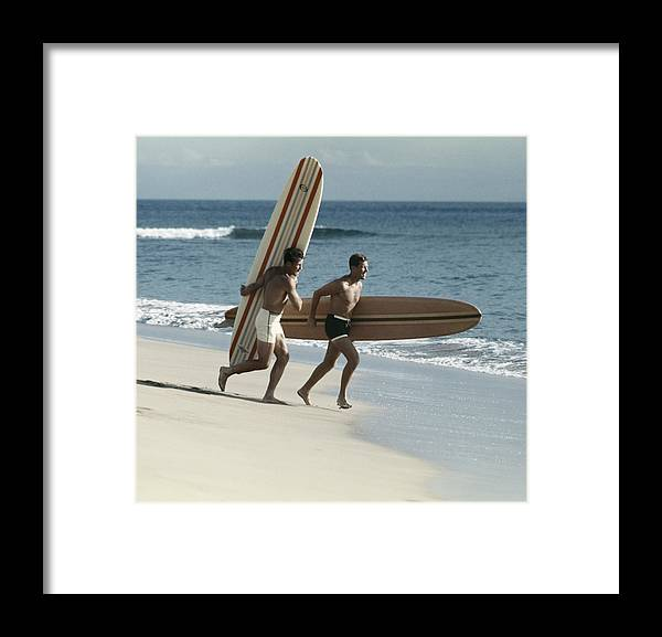 People Framed Print featuring the photograph Young Men Running On Beach With by Tom Kelley Archive