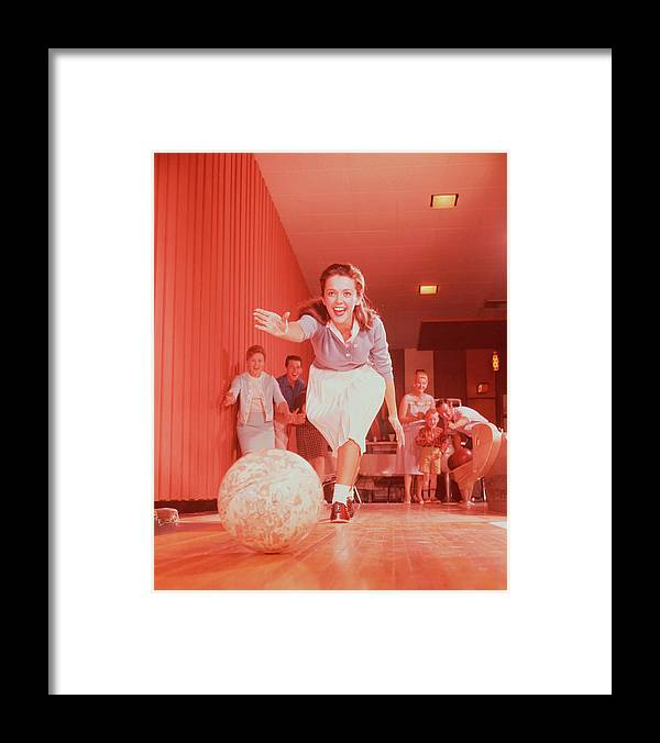 People Framed Print featuring the photograph Young Woman Bowling, Family Watching In by Fpg
