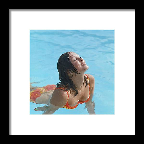 1973 Framed Print featuring the photograph Young Woman In Bikini At Swimming Pool by Tom Kelley Archive