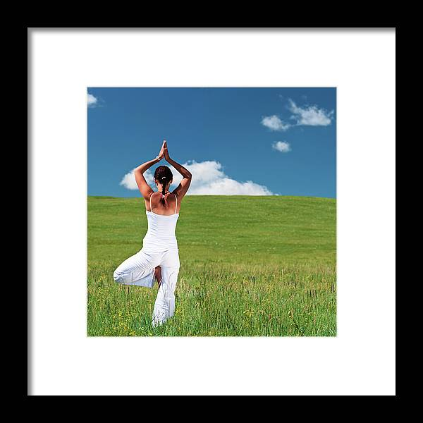 Scenics Framed Print featuring the photograph Young Woman Practicing Yoga by Hadynyah