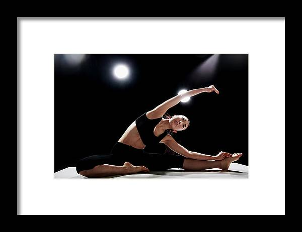 People Framed Print featuring the photograph Young Woman Stretching by Runphoto
