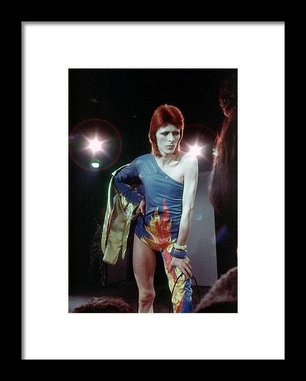 Ziggy Stardust - Persona Framed Print featuring the photograph Ziggy Stardust Era Bowie by Michael Ochs Archives